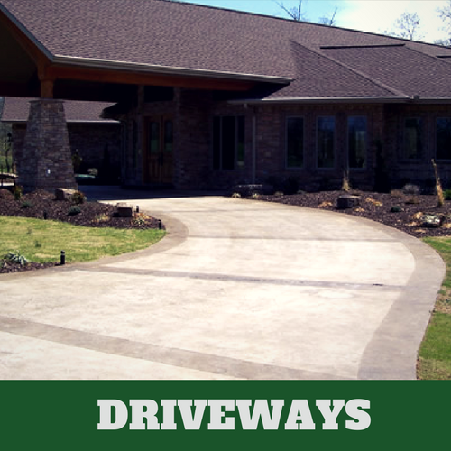 Two toned colored concrete driveway in Lansing, Michigan with brick home.
