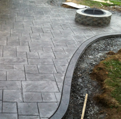 Stamped concrete patio with subtle landscaping.