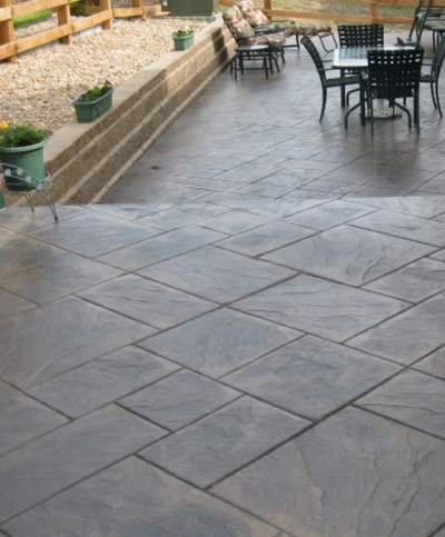 Concrete front porch with tile stamped stained concrete