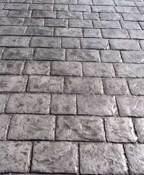 Old style cobblestone stamped concrete pattern.