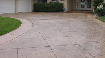 Concrete cutting done beautifully in a stamped concrete driveway.