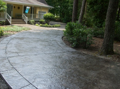 Perfectly curved cut, stamped and stained concrete.